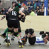 "Boston Roller Derby at Shriners Auditorium. Bay State Punishers (black) vs Twin State Vixens (white). Punishers' Alexandra Mabardy (16, ""Kait"") of Hubbardston, left, and Vixens'Pumpkin Carvher (13), knocked down. (SUN/Julia Malakie)"