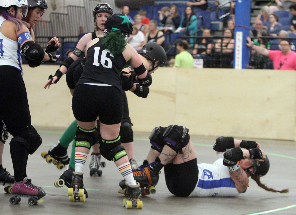 """. Boston Roller Derby at Shriners Auditorium. Bay State Punishers (black) vs Twin State Vixens (white). Punishers\' Alexandra Mabardy (16, \""""Kait\"""") of Hubbardston, left, and Vixens\'Pumpkin Carvher (13), knocked down. (SUN/Julia Malakie)"""