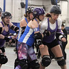 Boston Roller Derby at Shriners Auditorium. Cosmonaughties (blue) vs Harbor Horrors (purple). Terror Swift (89), left, and Loch Tess Monstah (211), right. (SUN/Julia Malakie)