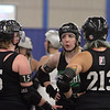 Boston Roller Derby at Shriners Auditorium. Bay State Punishers (black) vs Twin State Vixens (white). From left, Punishers' Sherry Thompson of Gardner (34), Emily Larson of Sterling (15), Stephanie Melo of Clinton (923), Maggie Lavello of Worcester (213) and Alexandra Mabardy of Hubbardston (16). (SUN/Julia Malakie)