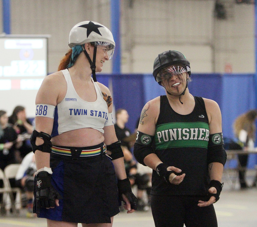 """. Boston Roller Derby at Shriners Auditorium. Bay State Punishers (black) vs Twin State Vixens (white). Vixens\' Pale Raptor (588) and Punishers\' Alyx Flerchinger (333, \""""Boots\"""") of Lowell. (SUN/Julia Malakie)"""