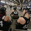 Boston Roller Derby at Shriners Auditorium. Bay State Punishers (black) vs Twin State Vixens (white). Punishers' Sherry Thompson of Gardner (34) and Linda Marchiony of Hudson, MA (42). (SUN/Julia Malakie)