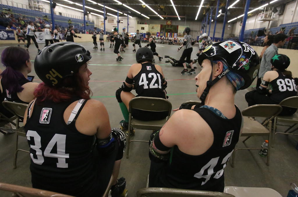 . Boston Roller Derby at Shriners Auditorium. Bay State Punishers (black) vs Twin State Vixens (white). Punishers\' Sherry Thompson of Gardner (34) and Linda Marchiony of Hudson, MA (42). (SUN/Julia Malakie)