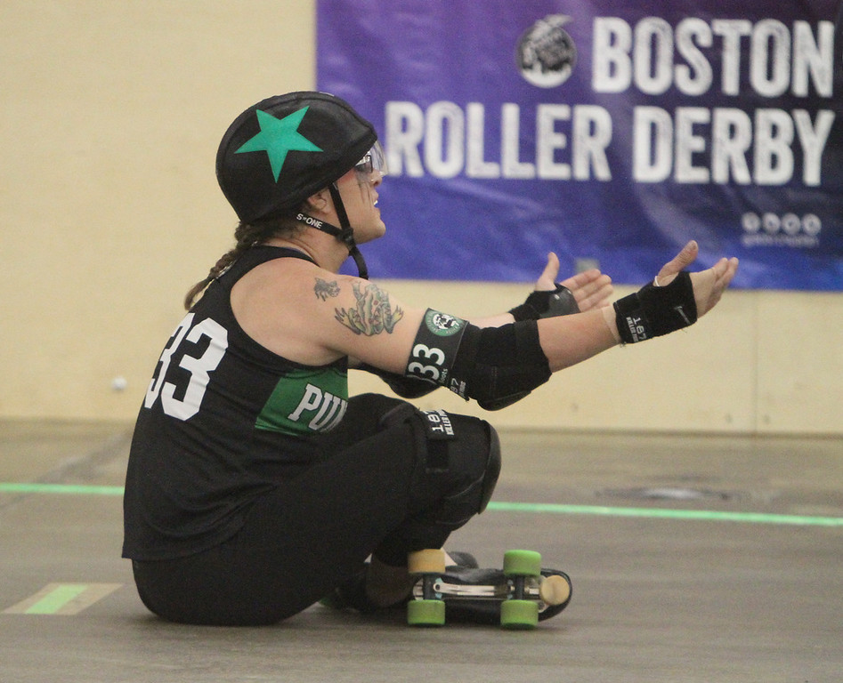 """. Boston Roller Derby at Shriners Auditorium. Bay State Punishers (black) vs Twin State Vixens (white). Punishers\' Alyx Flerchinger (333, \""""Boots\"""") of Lowell(SUN/Julia Malakie)"""