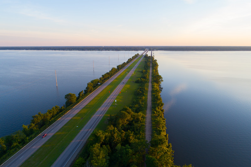 Aerial lake at dusk with a highway