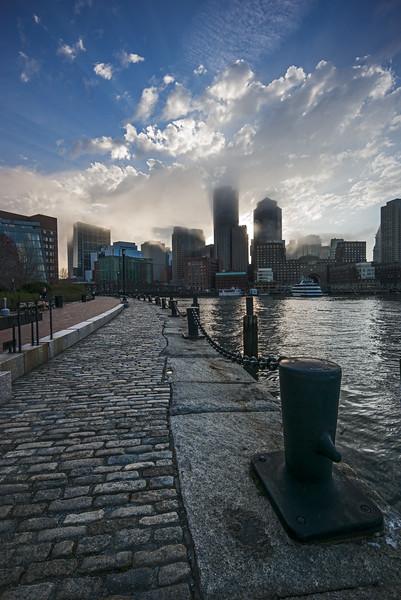 cobblestones on Fan Pier leading to foggy Boston
