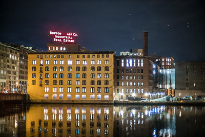Boston Wharf Co sign and Necco building at night with gulls
