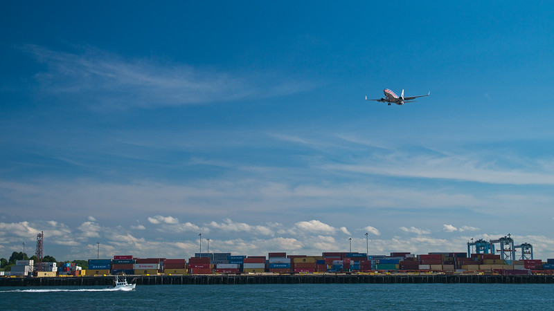 plane landing above South Boston container terminal