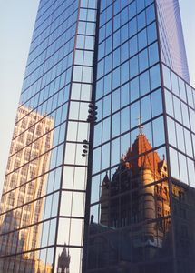 John Hancock Building reflecting nearby Trinity church and office building