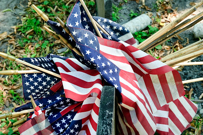 A cluster of flags over a headstone at the Granary Burial Ground.