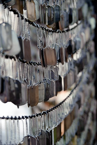 Iraq and Afghanistan MemorialThree walls filled with blank dog tags to commemorate all the men and woman that have served in the Irag and Afghanistan wars.