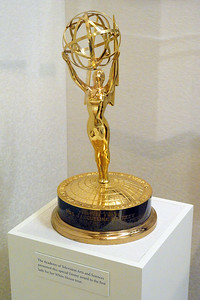 Emmy Award presented to Jackie for her White House tour.