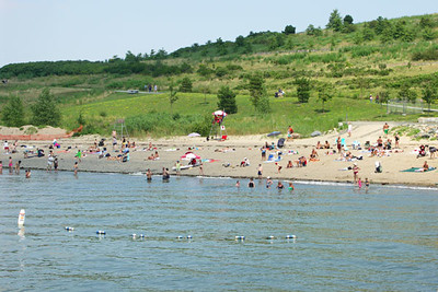 The sandy swimming beach next to the harbor