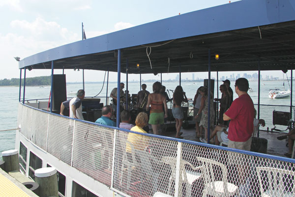 Three live bands performing on the New Boston Blues Cruise boat