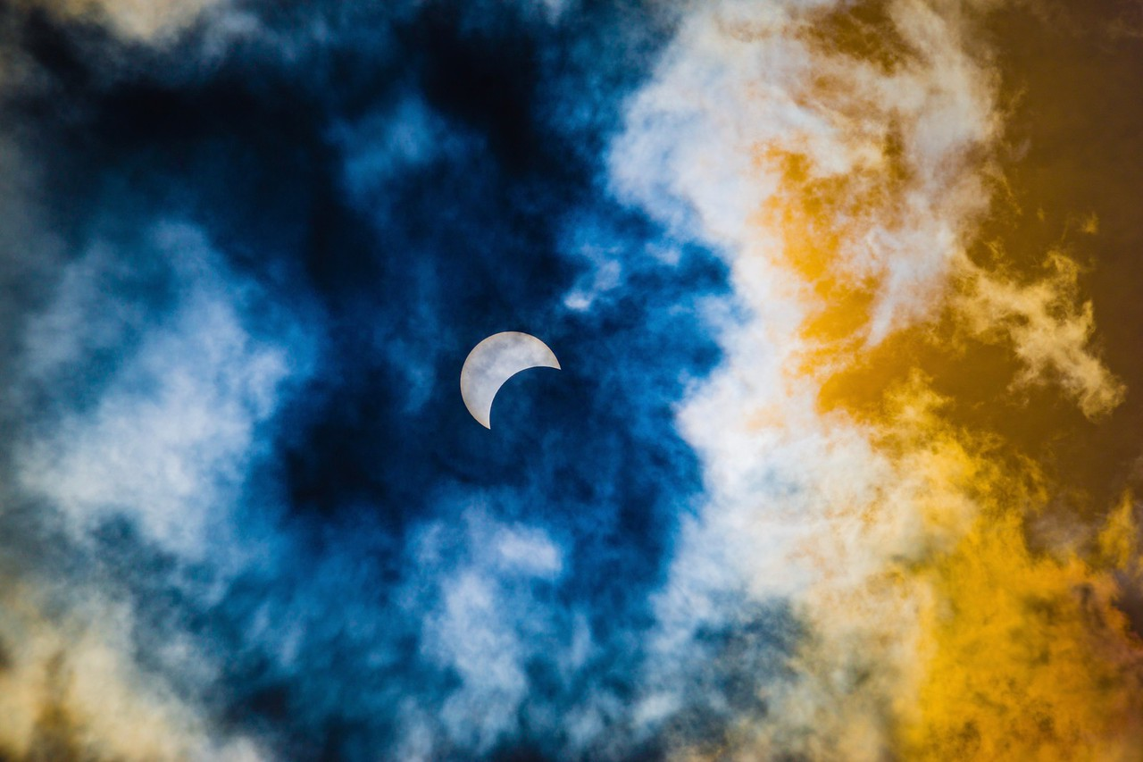 Solar Eclipse Through Clouds 2