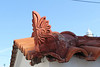 Roof tile ornament on a house in Karlovassi