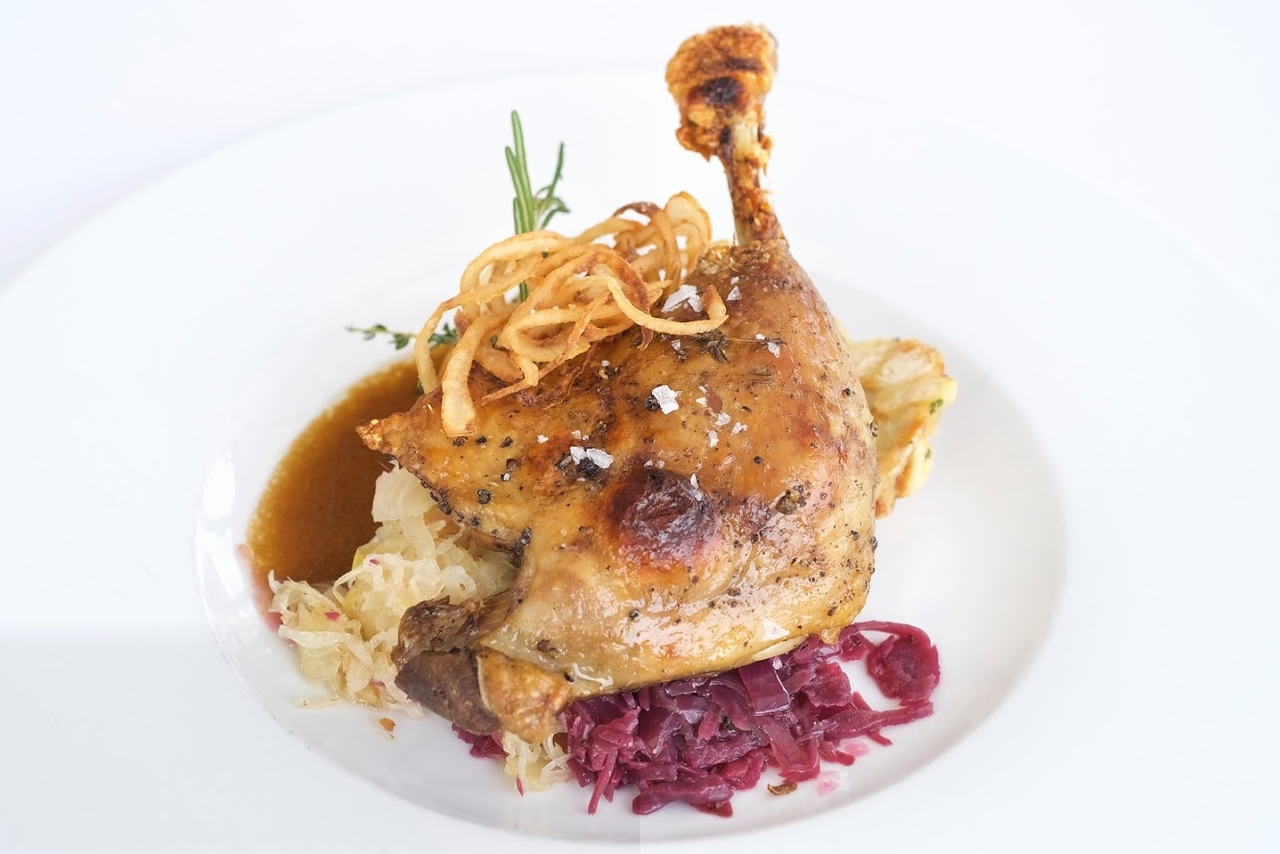 Confit of duck leg with red and white cabbage