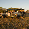 At about 6 PM we enjoyed sundowners (a British term for drinks and hors d'oeuvres consumed at sunset) near a lagoon – wine and homemade spicy cheese crackers. Enjoying the ambiance, we watched feisty hippos and birds in the lagoon as the sun set over the Okavango Delta. By Debbie Thompson on July 28, 2008.