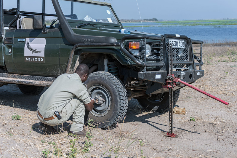 Changing-tire-on-jeep-near-Chobe-River