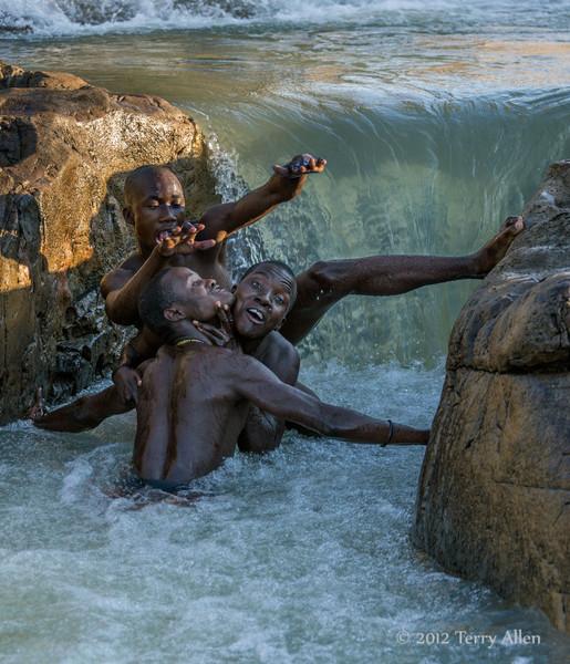 Himba-youth-horsing-around-in-Epupa-falls-1,-Namibia