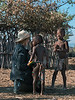 Talking-to-the-children,-traditional-Himba-kraal,-Epupa,-Namibia
