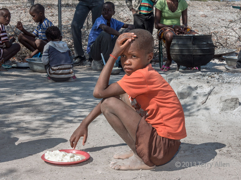 Young student with her dish of maize porridge from the school lunch program, Epupa school, Namibia