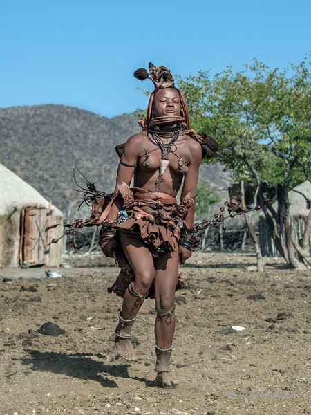 Himba-dancers-2,-Epupa,-Namibia<br /> <br /> The ground the women dance on in their bare feet consists of equal parts sand and cow and goat manure.  I was squeamish about walking on it even in my sandals, but the people appeared to be thriving, so who knows, maybe its good for you LOL