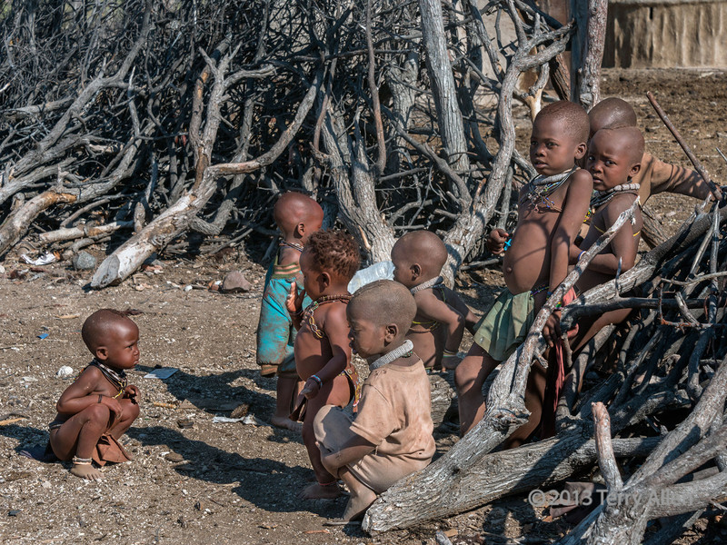 Himba-boys-hanging-out-by-the-boma-fence,-Epupa,-Namibia