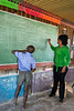 Teacher-and-school-child-at-blackboard,-Epupa,-Namibia
