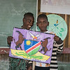 Students-showing-off-their-school-motto,-Epupa,-Namibia