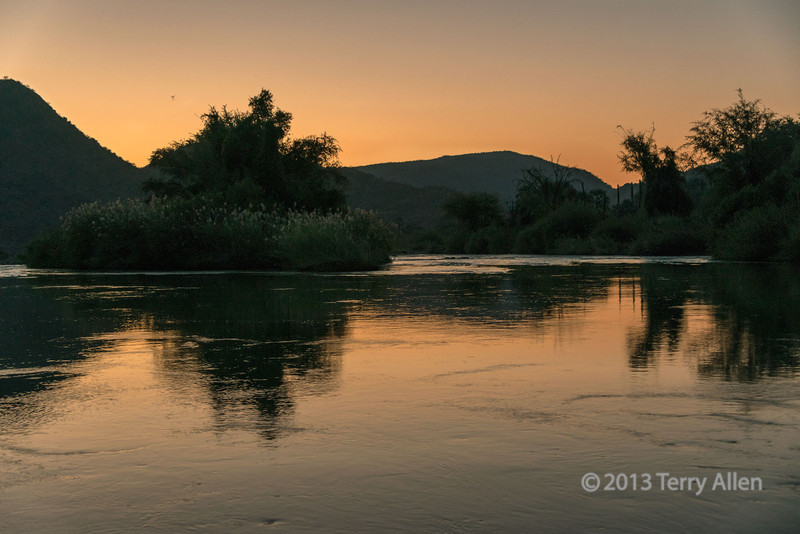 Reflected-sunset,-Kunene-River-above-Epupa-Falls,-Epupa,-Namibia
