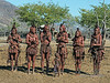 Small-boy-wants-to-dance-with-the-Himba-women,-Epupa,-Namibia