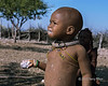 Himba-toddler-eating-a-handful-of-maize-porridge,-Epupa,-Namibia