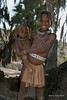 Himba-girl-with-little-brother,-Epupa,-Namibia