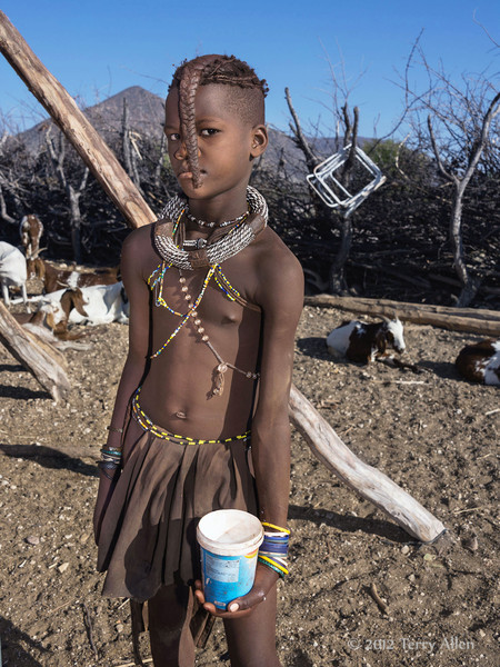 Himba-girl-with-her-container-of-goat's-milk,-Epupa,-Namibia
