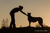Woman-&-pet-cheetah-silhouetted-at-sunset-1