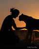 Woman-&-pet-cheetah-silhouetted-at-sunset-5