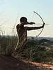 Bushman-in-tall-grass-shooting-arrow-4,-Intu-Africa