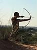 Bushman-in-tall-grass-shooting-arrow-4,-Intu-Africa