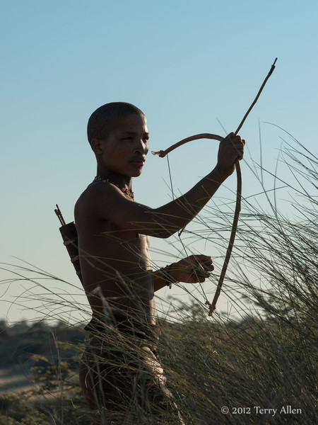 Bushman-in-tall-grass-shooting-arrow-3,-Intu-Africa