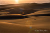 Sand-dunes-at-sunset-with-lens-flare and-sand-sparkles ,-Swakopmund