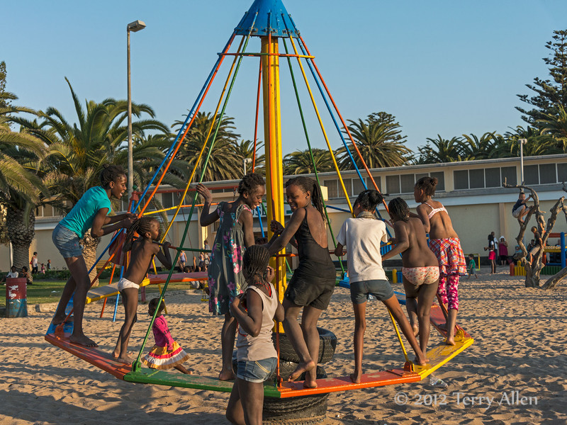 Swakopmund-children-on-merry-go-round,-Namibia