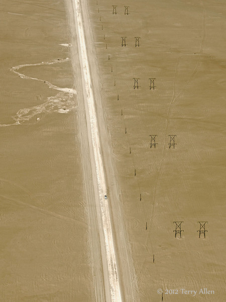 Desert-road-with-power-lines-and-a-truck,-near Swakopmund, Namibia