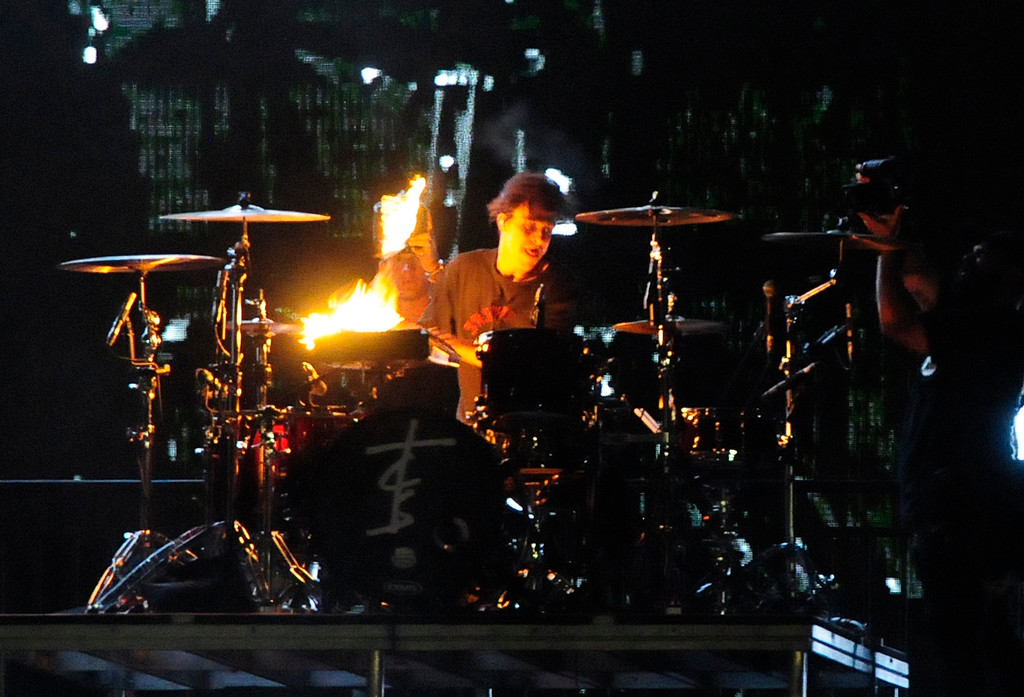 . NAPA, CA - MAY 25, Chainsmoker drummer Matt McGuire plays the drums with flaming drumsticks on the Midway Stage during the first day of BottleRock Napa Valley festival. (CHRIS RILEY/TIMES-HERALD)