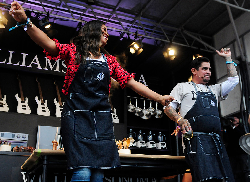 . NAPA, CA - MAY 25, Laila Ali dances with Aarón Sánchez on the Williams Sonoma Culinary Stage during the first day of BottleRock Napa Valley festival. (CHRIS RILEY/TIMES-HERALD)