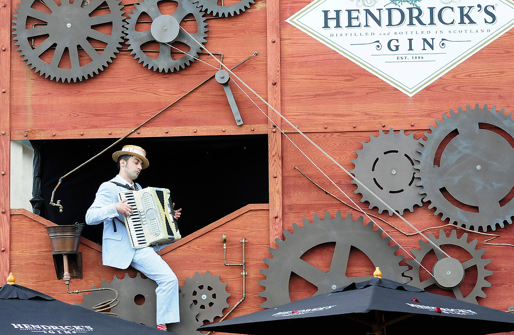 . NAPA, CA - MAY 25, Jasper De Tarr, gamesmith with Hendricks Gin, plays the accordian during the first day of BottleRock Napa Valley festival. (CHRIS RILEY/TIMES-HERALD)