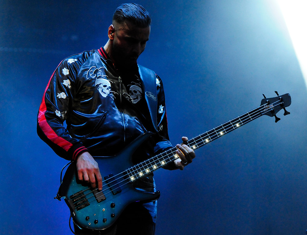 . NAPA, CA - MAY 25, Muse bassist Chris Wolstenholme performs on stage during the first day of BottleRock Napa Valley festival. (CHRIS RILEY/TIMES-HERALD)