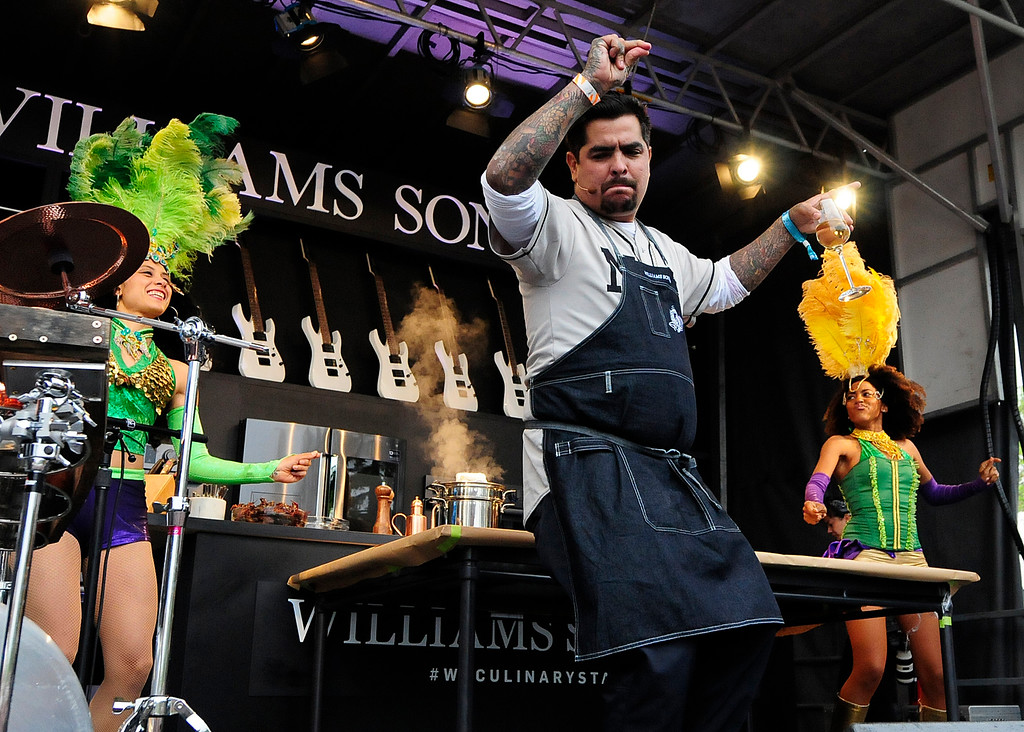 . NAPA, CA - MAY 25, Aarón Sánchez dances on the Williams Sonoma Culinary Stage during the first day of BottleRock Napa Valley festival. (CHRIS RILEY/TIMES-HERALD)