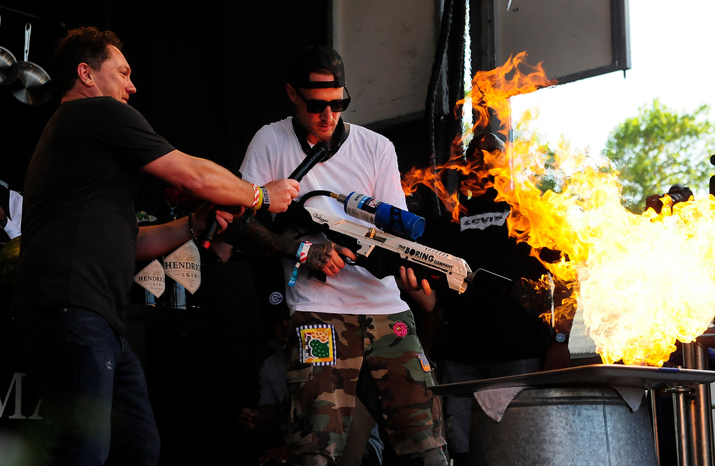 . NAPA, May 26- Chef Michael Voltaggio uses a flame thrower to blacken some chicken on the Williams Sonoma Culinary Stage on Saturday at BottleRock. (Chris Riley/Times-Herald)