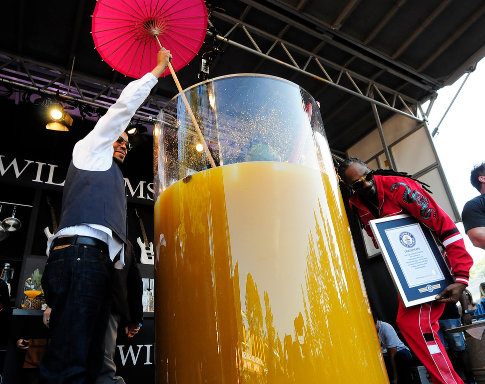 . NAPA, May 26- Warren G sticks the umbrella in the world record breaking gin and juice he created with Snoop Dogg and Michael Voltaggio on the Williams Sonoma Culinary Stage on Saturday at BottleRock. (Chris Riley/Times-Herald)